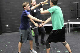 """League City resident Stephen Louis choreographed stage combat scenes for Clear Lake High School's production of """"The Trojan Women,"""" which continues Oct. 27-29 at the school."""