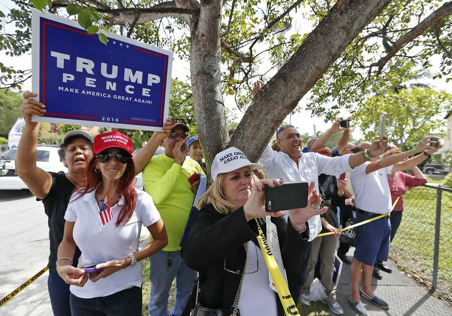 Trump supporters wave to Donald Trump after the presidential nominee leaves the Bay of Pigs museum after addressing the Brigade 2506, veterans of the Cuban battle on Tuesday, October 25, 2016. (Al Diaz/Miami Herald via AP) Photo: Al Diaz, Associated Press