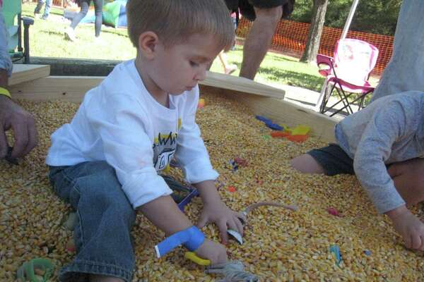 Max Wentzel plays in the corn pile at Holy Comforter Lutheran Church's inaugural Kingwood Oktoberfest Saturday, Oct. 22.