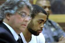 Emanuel Harris, charged with murder, represented by Attorney Dante Gallucci, appears in state Superior Court in Danbury Tuesday, Sept. 27, 2016, for the first day of jury selection in his trial.