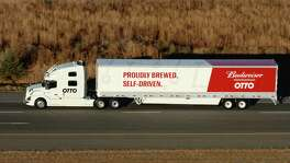 A self-driving truck built by Uber's unit Otto made a pioneering delivery of Budweiser beer in Colorado, making a 120-mile trip from Fort Collins through the center of crowded Denver to Colorado Springs.