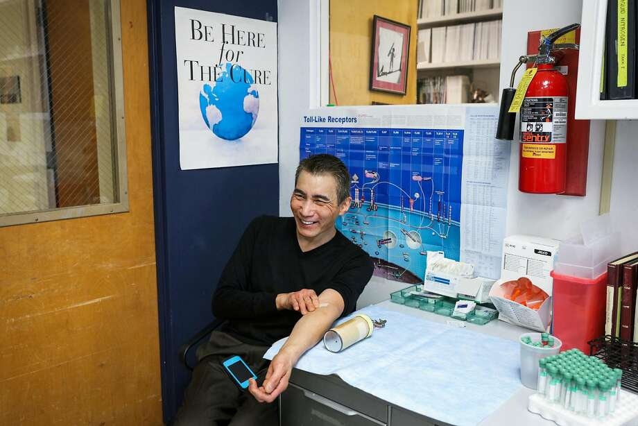 Lucky Choi, 59, who thinks he was infected with HIV in the late 1970s but is able to naturally fend off the virus, smiles after getting his blood drawn in Dr. Jay Levy's office at UCSF. Photo: Gabrielle Lurie, The Chronicle