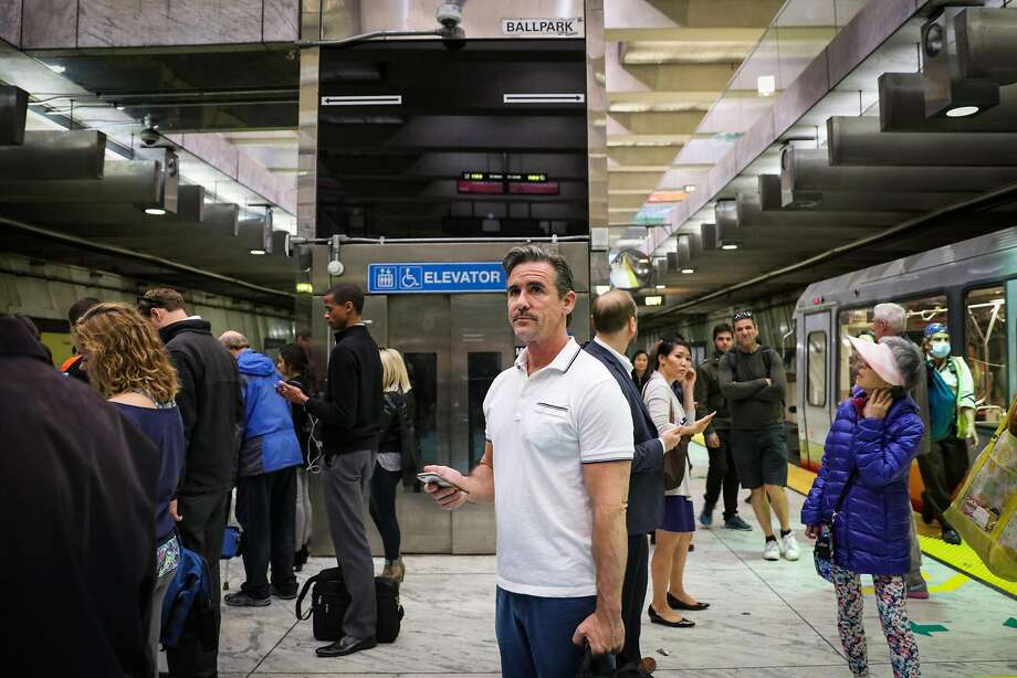 Kai Brothers (center), who has HIV but no signs of AIDS, waits for the BART train. Photo: Gabrielle Lurie, The Chronicle