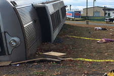 A Metro-North train lay on its side along a short length of train track as part of a disaster training exercise outside the New England Disaster Training Center at Camp Hartell in Windsor Locks, Conn. on Tuesday, Oct. 25, 2016. The exercise was meant to test the state's and federal government's response to a hypothetical terrorist bombing on a Metro-North commuter train.