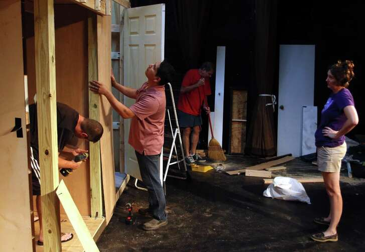 Amber Fabian looks over the work being done as Shawn Daniel, Felipe Bautista and Mike Fabian all work to get the set built.