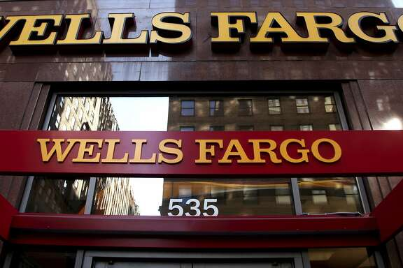 FILE - In this May 6, 2012, file photo, a Wells Fargo sign is displayed at a branch in New York. Wells Fargo has launched a new advertising campaign to address the company�s ongoing sales practices scandal and what it is doing to make things right for its customers. The campaign, which launched Monday, Oct. 24, 2016, is being rolled out nationally on the major network evening newscasts as well as the Sunday talk shows. Wells is also buying ads on the major Spanish language networks Telemundo and Univision, a bank spokesman said. (AP Photo/CX Matiash, File)