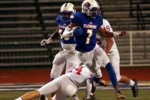 Clemens quarterback Frank Harris sidesteps a New Braunfels Canyon tackler earlier this season. (Staff photo)
