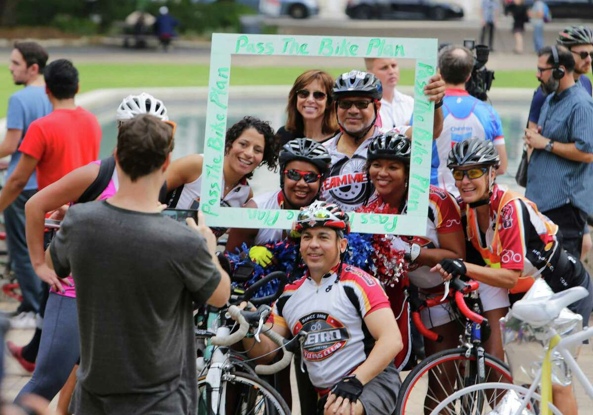 Cyclists pose in front of City Hall during a rally held to support Houston's bike plan on Oct. 25.