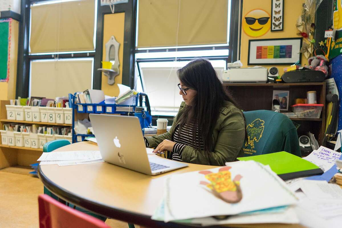 Second grade teacher Johanna Roldan prepares for class at Leonard R. Flynn Elementary School in San Francisco, Calif. on Tuesday, Oct. 25, 2016. Roldan was a recent victim of an eviction. SFUSD district officials as well as other city representatives are launching new support services to help teachers live in the city