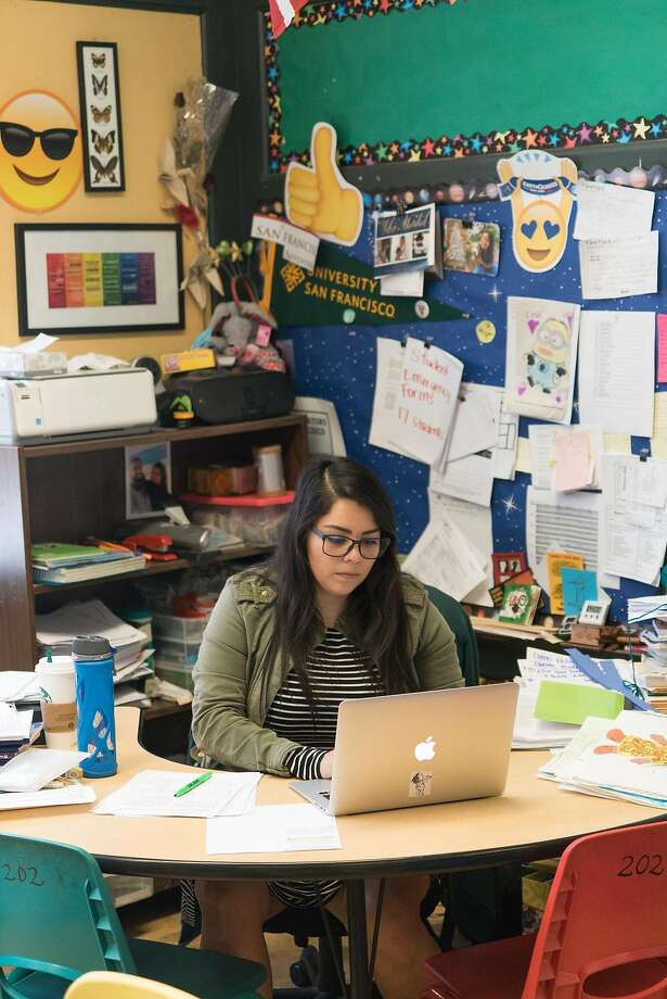 Second grade teacher Johanna Roldan prepares for class at Leonard R. Flynn Elementary School in San Francisco, Calif. on Tuesday, Oct. 25, 2016. Roldan was a recent victim of an eviction. SFUSD district officials as well as other city representatives are launching new support services to help teachers live in the city Photo: James Tensuan, Special To The Chronicle