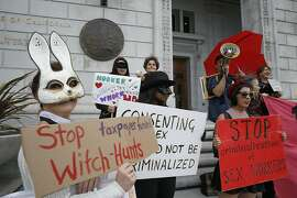 Happy Bunny (left), Taylor (middle), and Skyla Sensi (right) protest the raid on Backpage outside of the California Supreme Court on Tuesday, October 26, 2016, in San Francisco, Calif.