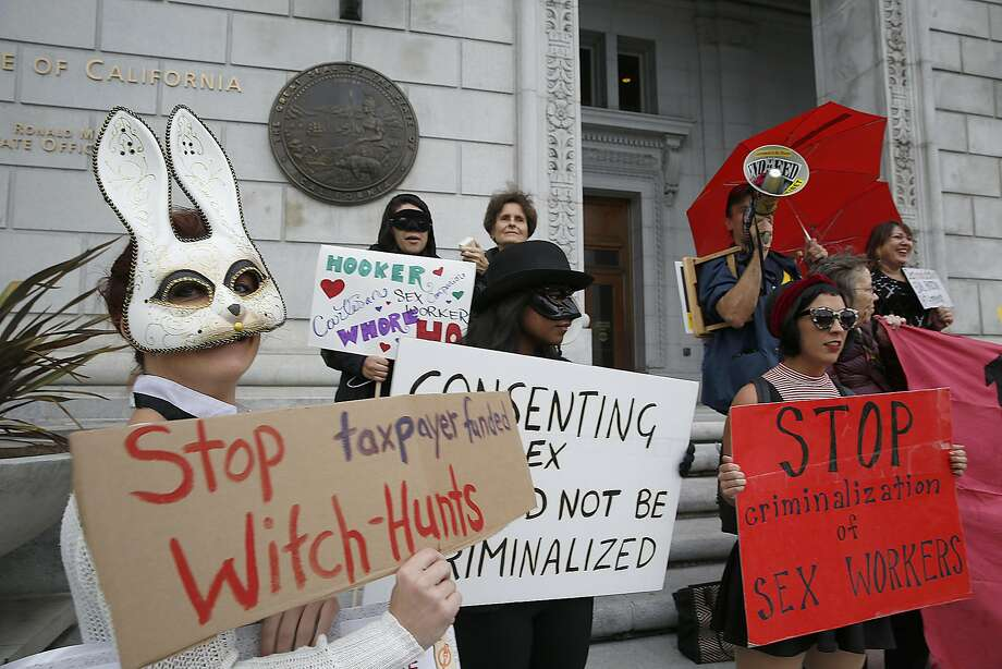 Happy Bunny (left), Taylor (middle), and Skyla Sensi (right) protest the raid on Backpage outside of the California Supreme Court on Tuesday, October 26, 2016, in San Francisco, Calif. Photo: Liz Hafalia, The Chronicle