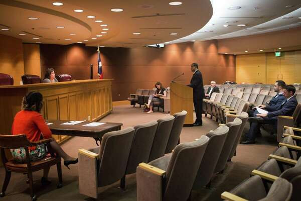 Steven Aleman, a lawyer with the advocacy group Disability Rights Texas, complains about the Texas Education Agency's special education enrollment target at a public meeting in June. The TEA did not respond to the complaint.