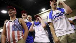 A group of high school boys support Republican presidential nominee Donald Trump at a campaign rally in Charlotte, N.C. Readers weigh in on the divise race between Trump and Democratic nominee Hillary Clinton.