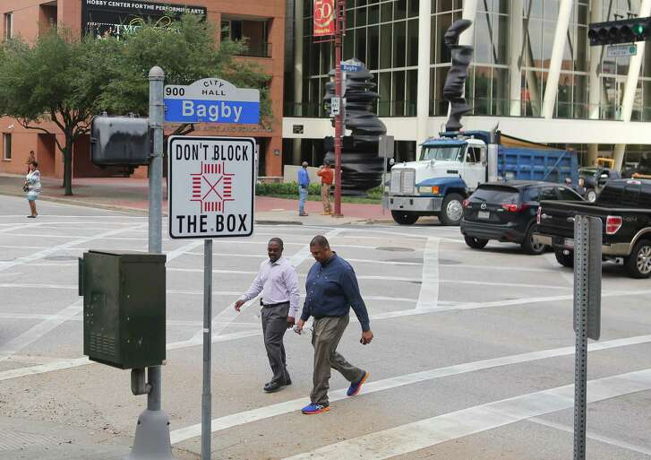 "New signs at the intersection of Walker and Bagby Streets urge drivers not to ""Block the Box"" that the city has created in the intersection, Tuesday, Oct. 25, 2016, in Houston."