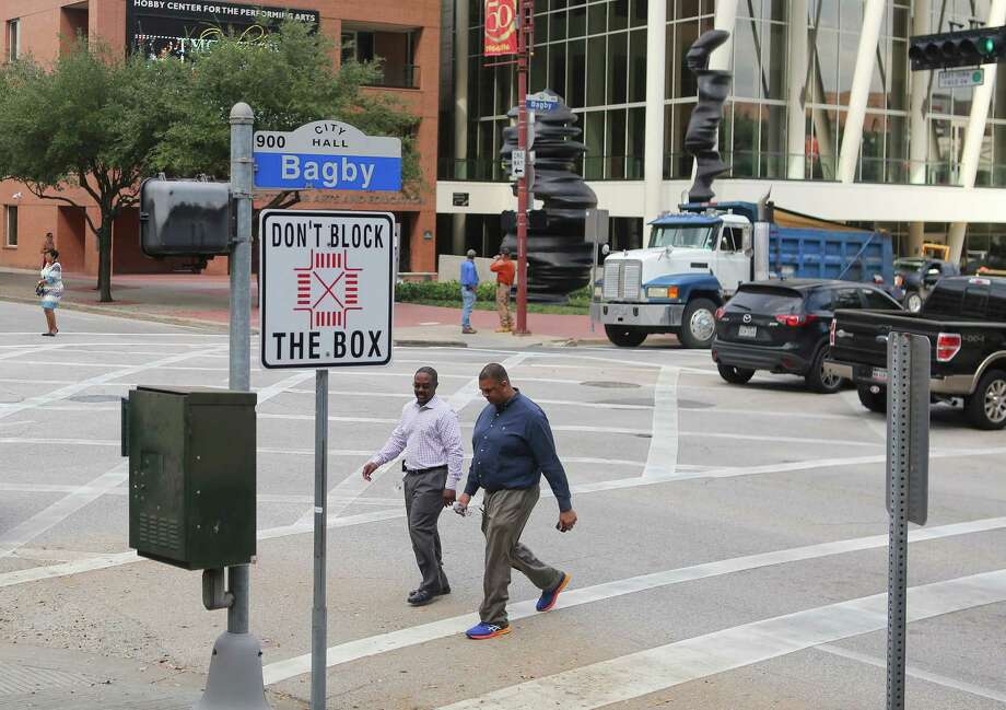 "Signs at the intersection of Walker and Bagby Streets in downtown Houston urge drivers not to ""Block the Box,"" seen on Oct. 25. City officials have made a priority of keeping intersections clear. Photo: Houston Chronicle / © 2016 Houston Chronicle"