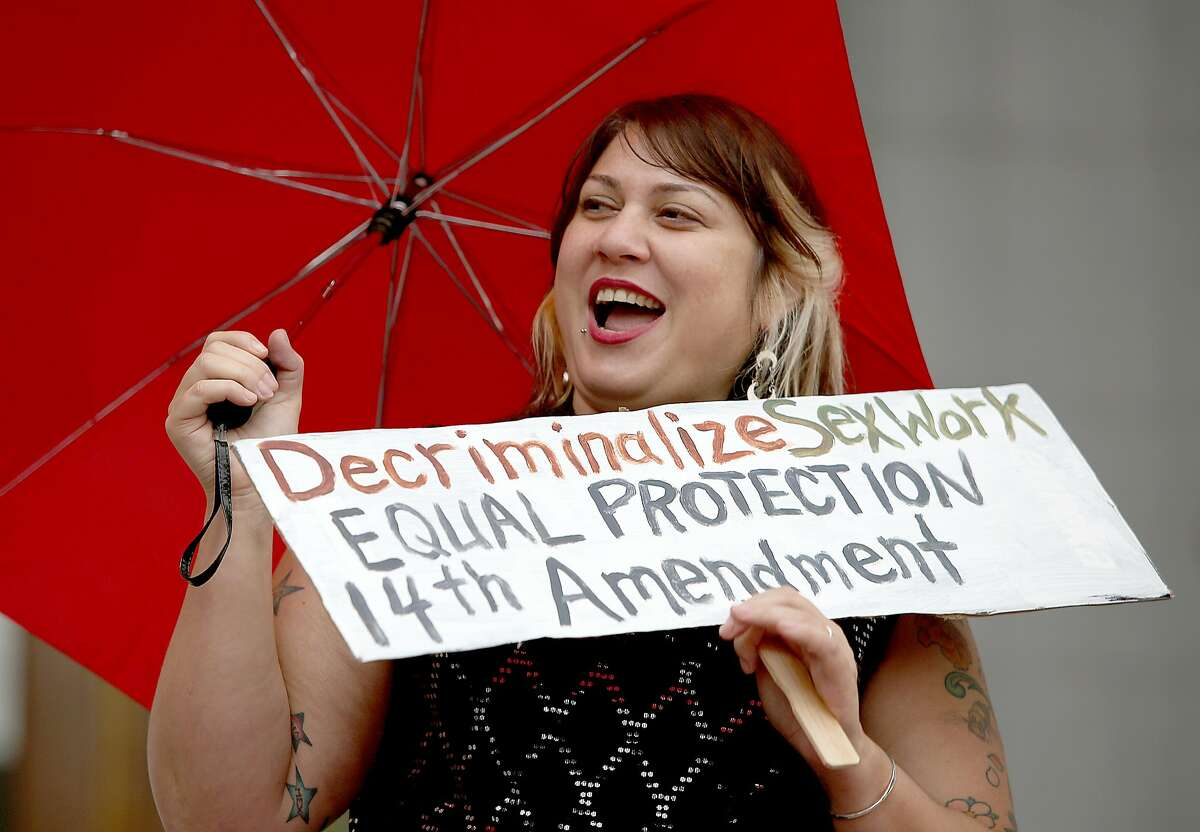 Sophia Amelia (left) protests the raid on Backpage outside of the California Supreme Court on Tuesday, October 26, 2016, in San Francisco, Calif.