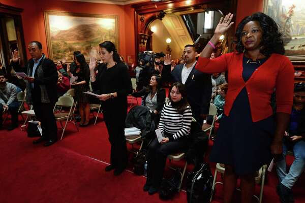 U.S. Citizenship and Immigration Services (USCIS) presents 20 candidates for naturalization to the U.S. District Court for the District of Connecticut, including Heather Brown of Jamaica, right, on Tuesday, October 25, 2016, at Lockwood-Mathews Mansion Museum in Norwalk, Conn.  The Honorable Stefan R. Underhill, United States District Judge, District of Connecticut, administered the Oath of Allegiance to America's newest citizens during the naturalization ceremony.
