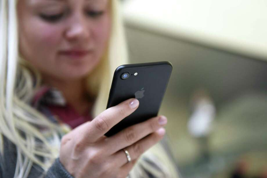 A customer views an iPhone 7 smartphone at an Apple Inc. in San Francisco, California. The mere presence of your smartphone reduces your cognitive capacity — even if it's turned off, according to a new study from the McCombs School of Business at The University of Texas at Austin. Photo: Bloomberg News File Photo / © 2016 Bloomberg Finance LP