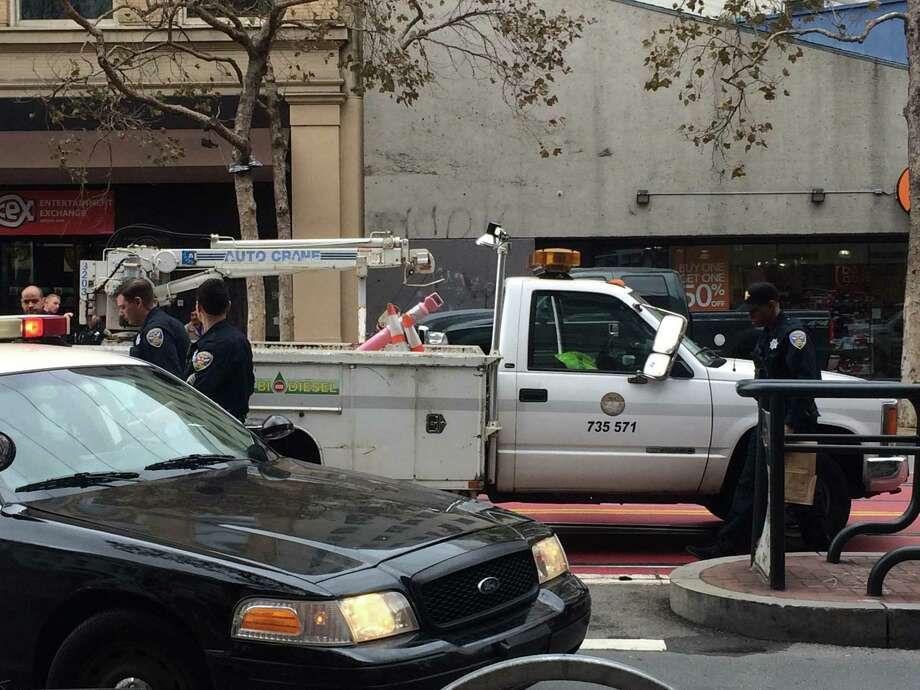 The truck was in the middle of the street near Market and Fifth streets in San Francisco when the driver got into a yelling match with someone outside his car that resulted in the stabbing of the driver. Photo: Sarah Ravani / The San Francisco Chronicle / Sarah Ravani / The San Francisco Chronicle