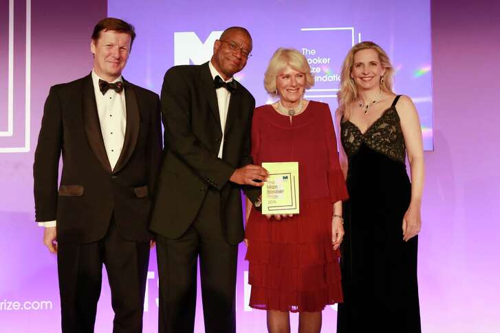 LONDON, ENGLAND - OCTOBER 25:  (L-R) Luke Ellis, Winner of the 2016 Man Booker Prize for his novel 'The Sellout', Paul Beatty, Camilla, Duchess of Cornwall and Dr Amanda Foreman attend the 2016 Man Booker Prize at The Guildhall on October 25, 2016 in London, England.