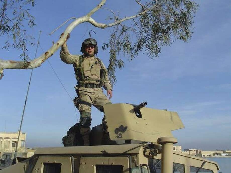 """In an undated handout photo, National Guard Capt. Christopher Van Meter during his deployment in Iraq. Van Meter is one of nearly 10,000 National Guard troops in California who have been ordered to repay re-enlistment bonuses and other incentives doled out during the wars in Iraq and Afghanistan, after an audit in 2011 uncovered widespread fraud, mismanagement and overpayment by the guard in the state. """"I spent years of my life deployed, missed out on birthdays and deaths in the family, got blown up. It's hard to hear after that that they say I haven't fulfilled my contract,"""" said Van Meter. (Christopher Van Meter  via The New York Times) -- NO SALES; FOR EDITORIAL USE ONLY WITH MILITARY BONUS REPAY  BY DAVE PHILIPPS FOR OCT. 25, 2016. ALL OTHER USE PROHIBITED. -- Photo: CHRISTOPHER VAN METER, NYT"""