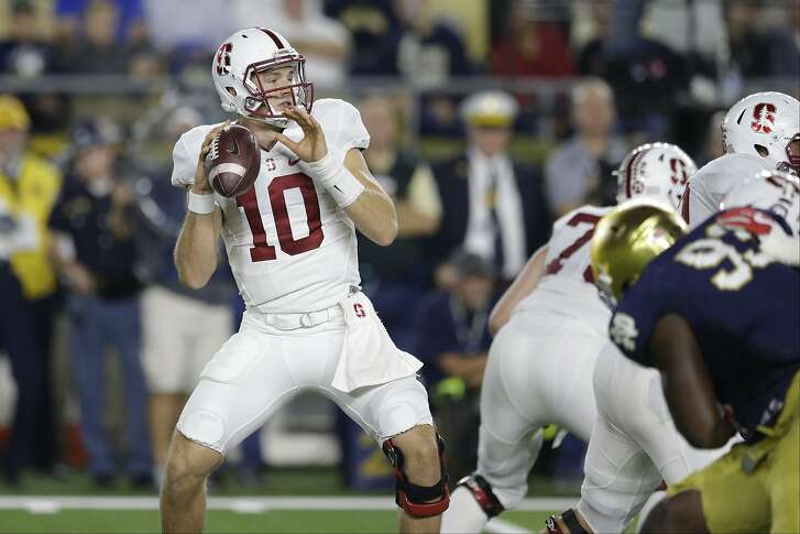 Stanford quarterback Keller Chryst (10) throws against Notre Dame during the second quarter of an NCAA college football game in South Bend, Ind., Saturday, Oct. 15, 2016. (AP Photo/Michael Conroy)