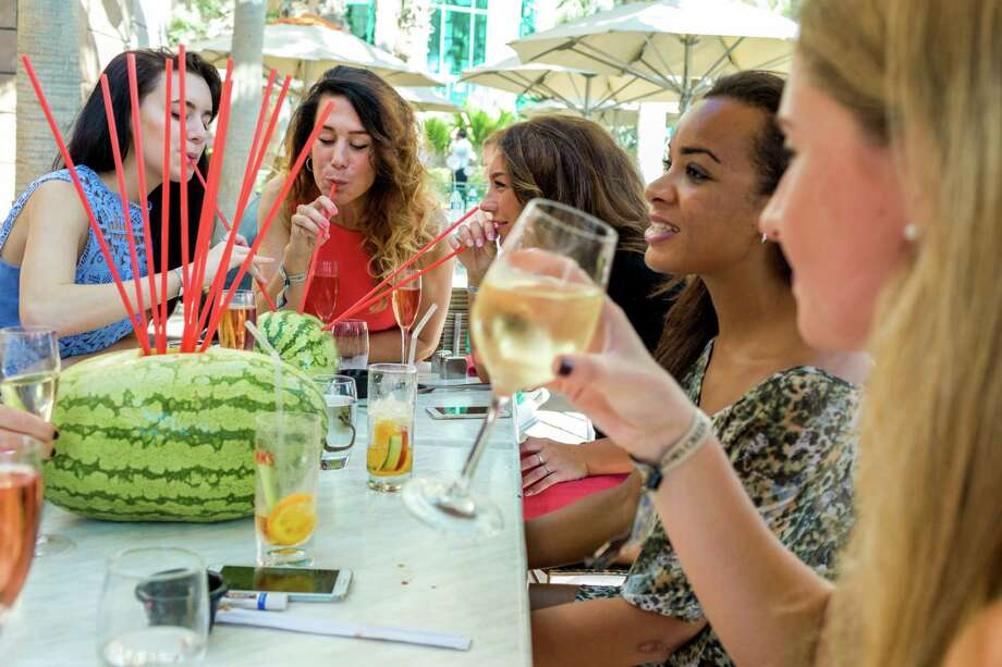 Women enjoy brunch at a  hotel and resort in Dubai, United Arab Emirates. Photo: CHRISTOPHE VISEUX, STR / NYTNS
