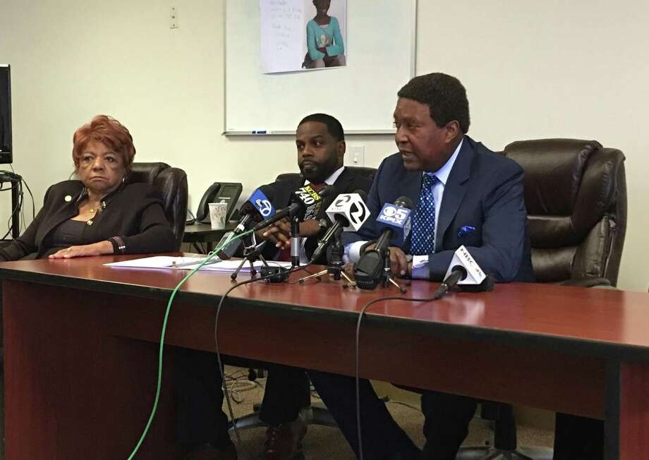John Burris (right) speaks Tuesday at a news conference to announce the filing of a lawsuit against a Redwood City hotel. Photo: Kimberly Veklerov
