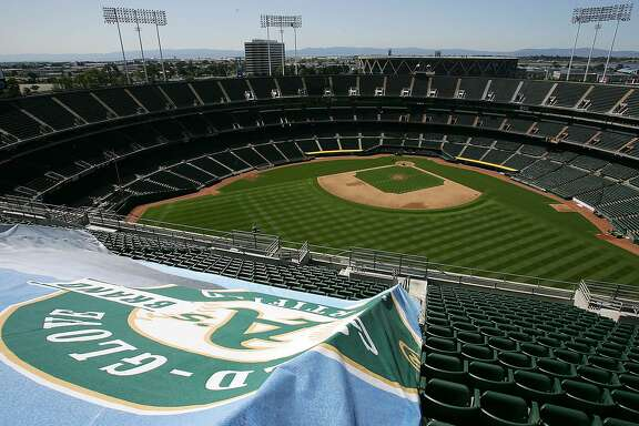 An Oakland Athletics team banner hangs from the upper deck at the Coliseum in Oakland, Calif. on Wednesday, March 30, 2005. Baseball's owners unanimously approved the sale of the Athletics Wednesday to Los Angeles real estate developer Lewis Wolff who has repeatedly said his priority is to build a baseball-only stadium in Oakland. (AP Photo/Marcio Jose Sanchez)