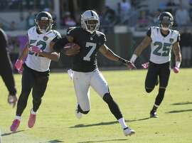 Oakland Raiders punter Marquette King (7) outruns Jacksonville Jaguars outside linebacker Hayes Pullard (52) and defensive back Peyton Thompson (25) after a botched punt during the fourth quarter of an NFL football game Sunday, Oct. 23, 2016, in Jacksonville, Fla. (AP Photo/Phelan Ebenhack)