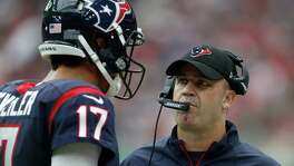 Houston Texans head coach Bill O'Brien talks with quarterback Brock Osweiler (17) during the first quarter of an NFL football game at NRG Stadium, Sunday, Oct. 2, 2016 in Houston.  ( Karen Warren / Houston Chronicle )