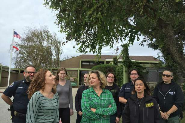 Employees from the Peninsula Humane Society gathered outside the animal shelter to raise concerns of poor working conditions and improper care of animals inside the shelter at a press conference on Monday.