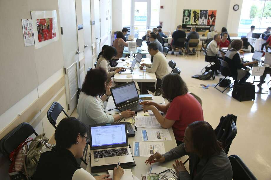 A health insurance fair on the first day of open enrollment for the Affordable Care Act at the the Richmond Recreation Center in San Francisco, Nov. 1, 2015. Despite the growth of the new health care marketplaces, most insured people of working age receive health coverage through their employers. Photo: JIM WILSON, NYT
