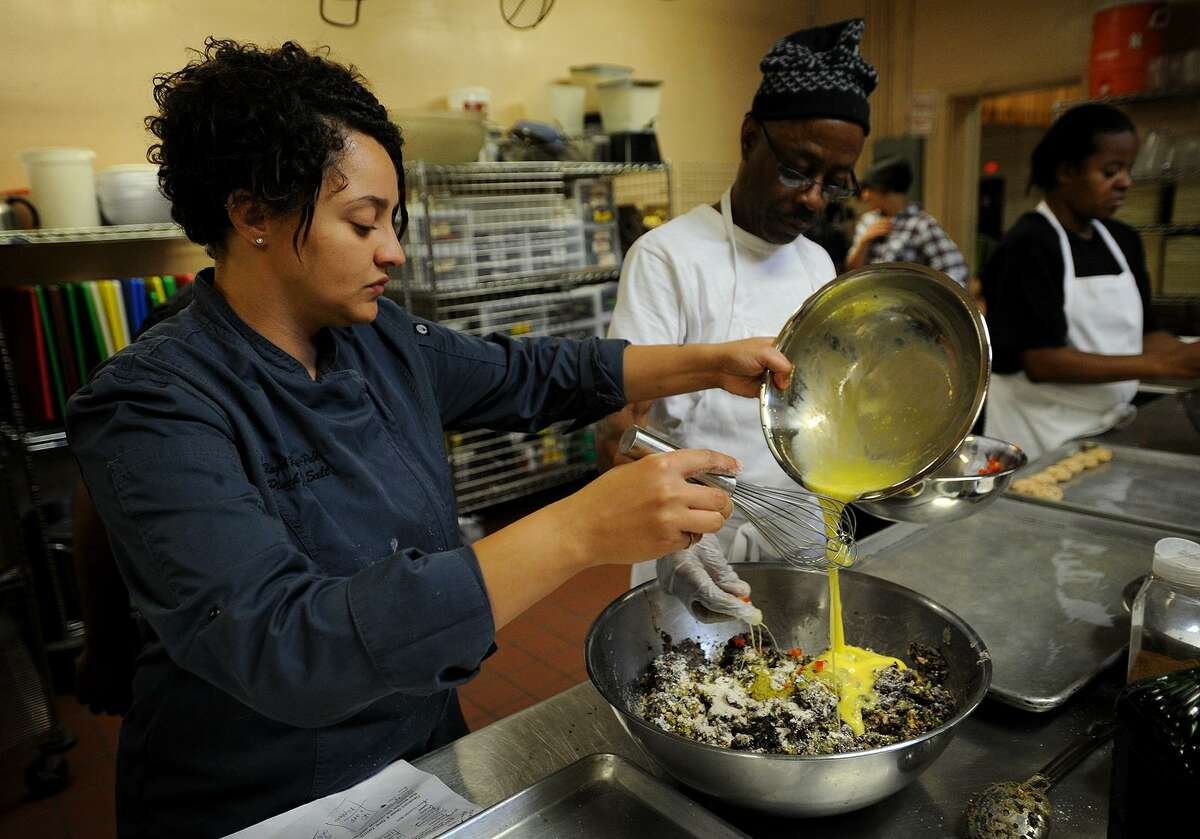 Chef Raquel Rivera-Pablo, left, combines the ingredients for black bean burgers with cooking student Randy Jackson, both of Bridgeport, during an intensive twelve week cooking course in the commercial kitchen at the United Congregational Church at 877 Park Avenue in Bridgeport, Conn. on Tuesday, October 25, 2016.