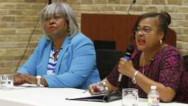 Barbara Gervin-Hawkins listens while Laura Thompson,R talks during debate between candidates for Texas House District 120, Democrat Barbara Gervin-Hawkins and independent Laura Thompson. Sponsored by San Antonio Observer at  Claude W. Black Community Center. Photos taken on 10/20/2016