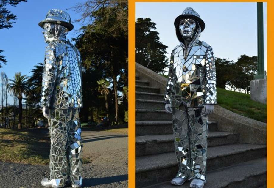 """MIRROR MAN (2015): This epic accomplishment in costuming from The Poop readers (and my former neighbors) Will and Michelle W.: """"We made this for Halloween last year for our boy after he saw """"Mirror Man"""" appear at an Arcade Fire concert - minds were blown. My husband and I were naively convinced we'd throw it together with ease (we HAD after all accomplished a fully operational/accurate battery powered LED-lit Tron costume the year before so this would be a breeze - pfft!). We embarked on a slightly insane 2-month, 75 hr +/- journey....one honed piece of mirror at a time and countless hot glue burns. Despite its THIRTY pounds, kiddo was crazy about the beams of light cast in every direction and the unexpected side effect of sounding like wind chimes when he walks. He is 10 now and still loves it, so he's reprising Mirror Man for Halloween 2015. Bless his heart for not outgrowing it ..."""""""