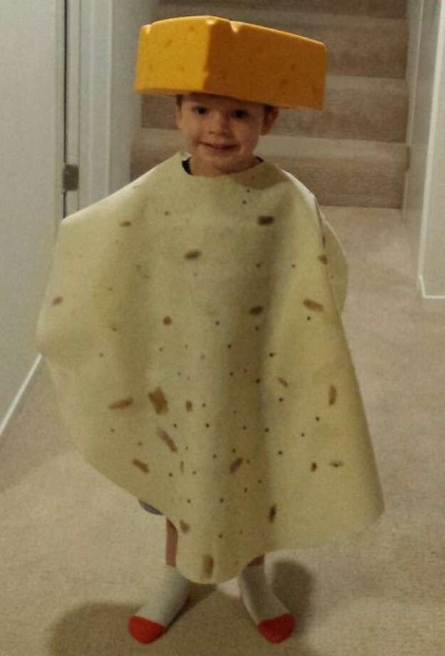 """TORTILLA AND CHEESE (2015): Contest veterans know that I LOVE it when a kid asks their parents to be something completely random, and the parents comply. Four-year-old Will was such a case. """"He wanted to be a tortilla with cheese,"""" his parents write, and he walked out of the house on Halloween as the best damn tortilla and cheese his neighborhood has ever seen. Good job, parents."""