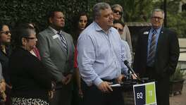 Local businessman Justin Holley (center, at lectern) speaks Tuesday October 25, 2016 at a news conference held at Hotel Havana in downtown San Antonio. The group was there with leadership from Equality Texas to voice their opposition to any legislation that would legalize discrimination against lesbian, gay, bisexual and transgender Texans. Small business owners from 36 municipalities across Texas signed a letter highlighting the damage discriminatory legislation does to the economy. Equality Texas works to secure full equality for lesbian, gay, bisexual, and transgender Texans through political action, education, community organizing, and collaboration.
