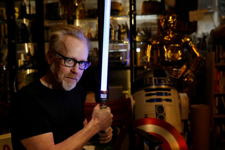 "Adam Savage of ""Mythbusters"" with a light saber at his San Francisco workshop in 2016. Photo: Lea Suzuki / The Chronicle 2016"