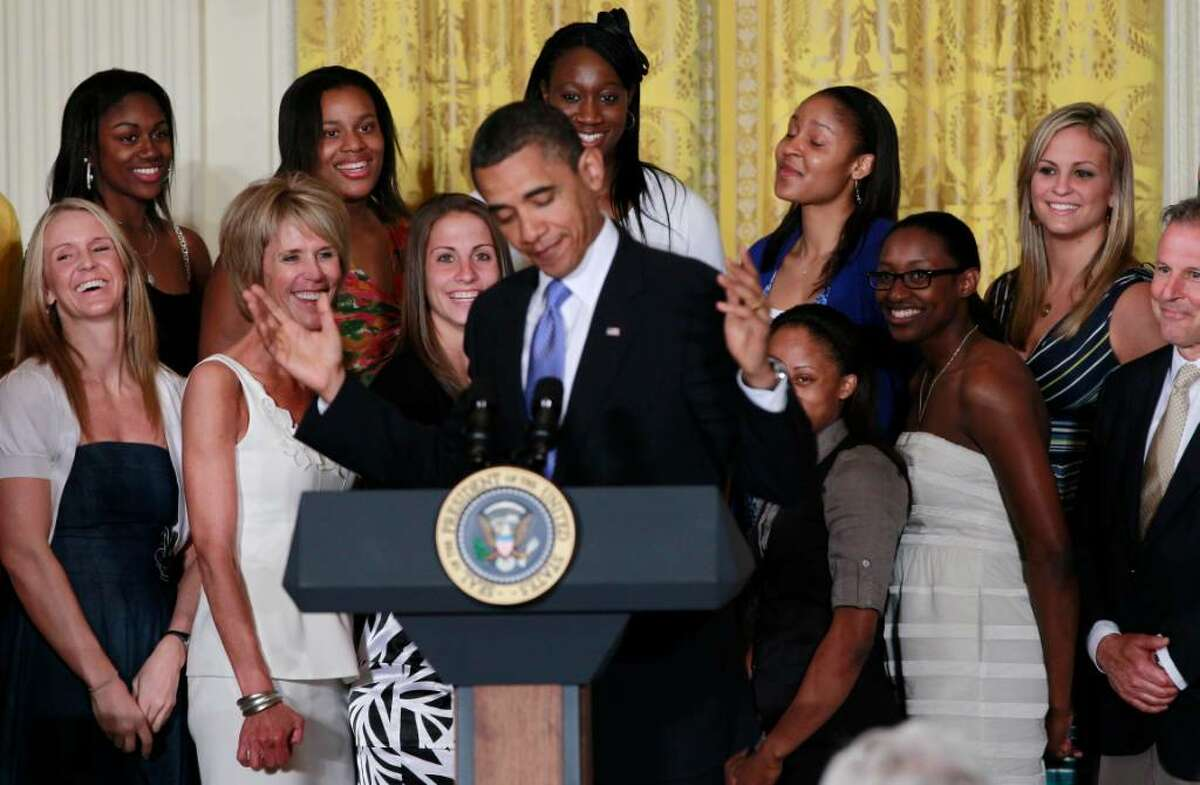 The 2010 NCAA champion University of Connecticut women's basketball team reacts as they are honored by President Barack Obama in the East Room of the White House in Washington, Monday, May 17, 2010. Pictured rear center are Tina Charles and Maya Moore, second right. (AP Photo/Charles Dharapak)