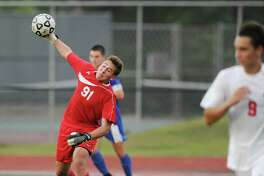 Greenwich goalie Christopher MacKay, above, and a defense featuring, in part, Paul Ruh, below right, has helped the Cardinals to an unbeaten regular season and the top seed in the upcoming FCIAC playoffs.