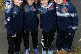 These four members of the Brien McMahon girls soccer team, from left, Chloe Ortolano, Peyton McNamara, Sophia Tarasidis, and Olivia Leone were all members of the Norwalk Blue Thunder U-11 Youth Soccer team that won a Connecticut Cup state championship back in 2011.