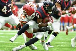 Houston Texans running back Tyler Ervin (34) is hit by Kansas City Chiefs linebacker Dezman Moses (54) during the first half of an NFL football game Sunday, Sept. 18, 2016, in Houston. (AP Photo/Eric Christian Smith)