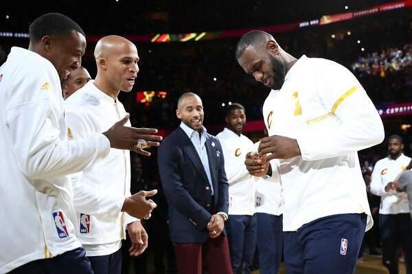 CLEVELAND, OH - OCTOBER 25:  Channing Frye #8 and Richard Jefferson #24 react with LeBron James #23 of the Cleveland Cavaliers after receiving their championship rings before the game against the New York Knicks at Quicken Loans Arena on October 25, 2016 in Cleveland, Ohio.  (Photo by Ezra Shaw/Getty Images)