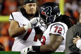 Texans guard Xavier Su'a-FIlo, left, consoles fellow lineman Derek Newton after Newton was injured Monday night.