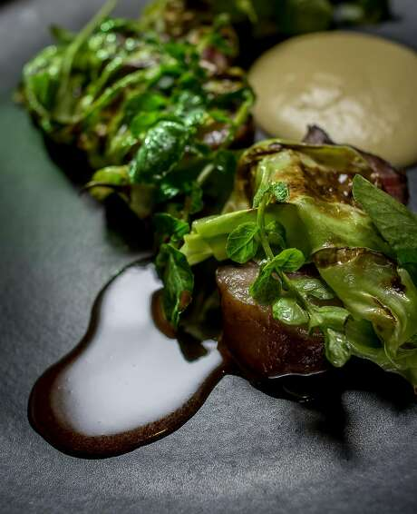 Entrecôte with potato, cabbage, and cress at Nico's. Photo: John Storey, Special To The Chronicle