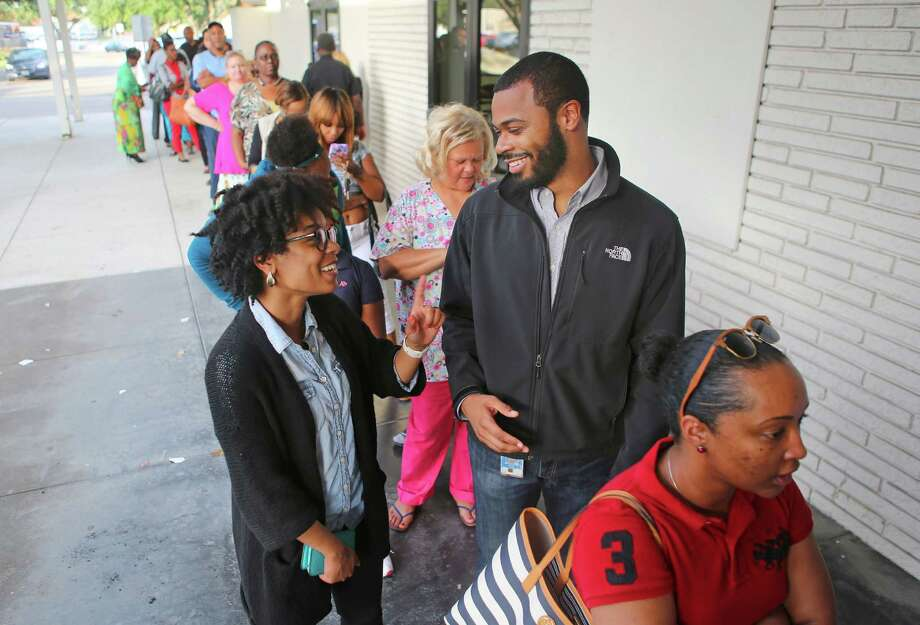 Kenya Hunt and husband, Clyde, in line to vote at the Palm Center on Tuesday, said they have long supported Hillary Clinton. Other blacks supporting Clinton say they are not as enthusiastic. Photo: Mark Mulligan, Staff / © 2016 Houston Chronicle