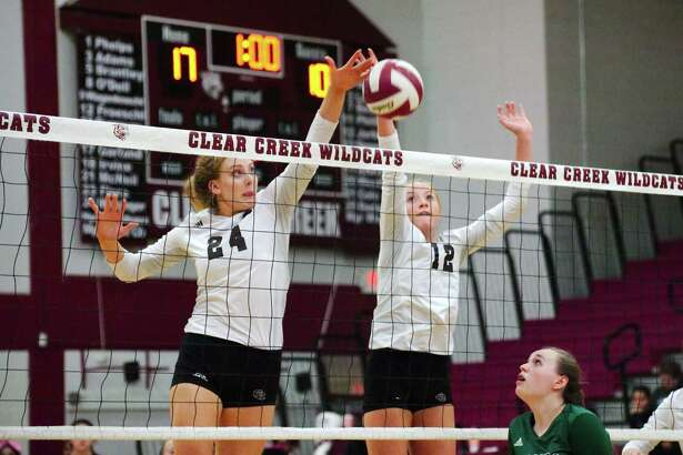 Jenna Metzinger (24) and Hannah Froeschl of Clear Creek cover the middle during a District 24-6A volleyball match Tuesday night against Clear Falls.