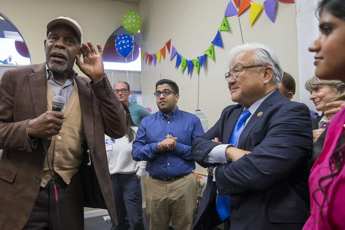 From left: Danny Glover, Vedant Patel (in blue shirt), Rep. Mike Honda, D-Calif., and Tara Sreekrishnan, who is the regional field director for Honda, (in pink) during a get-out-the-vote rally at Honda's campaign headquarters, on Tuesday, Oct. 25, 2016 in Cupertino, Calif.